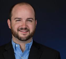 Headshot of Zack Toates, Senior VP of Zoning